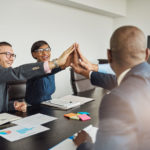 Employee Engagement Breakthroughs: Image is diverse team members celebrating.
