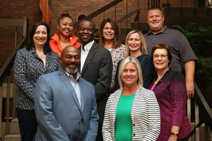 Creating Cohesive Teams: Image is diverse team members.
