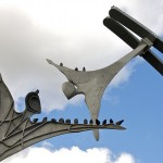 Exceptional Empowerment: Image is flying statues.