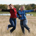 Indulgent Customer Experience; Image is two people dancing in a field.