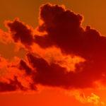 Leadership Drama: Image is red sky w/ dark cloud.