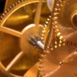 Leadership People Skills Timing: Image is golden gears.