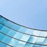 Increase Success: Image is mirrored tiles on building reflecting the blue sky.