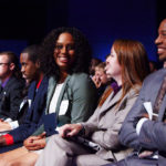 Conference Speaker Diversity: Image is diverse people at conference