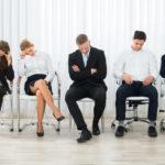 Leaders Foolishly Minimize Employees: Image is diverse disengaged employees.
