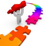 Essential People Skills Mindset: Image is humanoid putting the last puzzle piece in place.