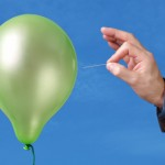 People Skills:Image is person w/ pin popping balloon